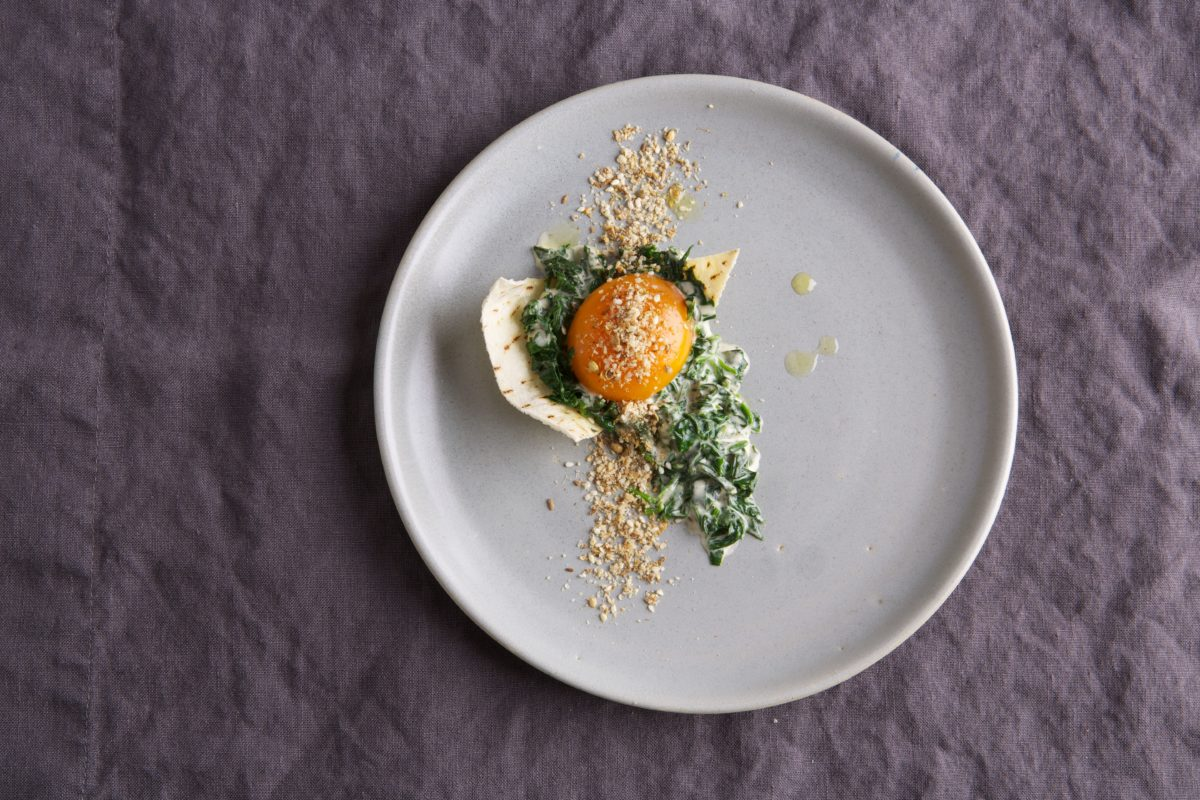 Slow cooked duck egg with creamed spinach and dukkah